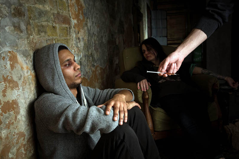 young man being offered heroin